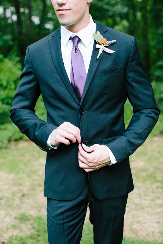elegant groom look in purple tie