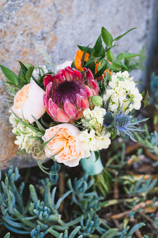 protea thistle and garden rose bouquet