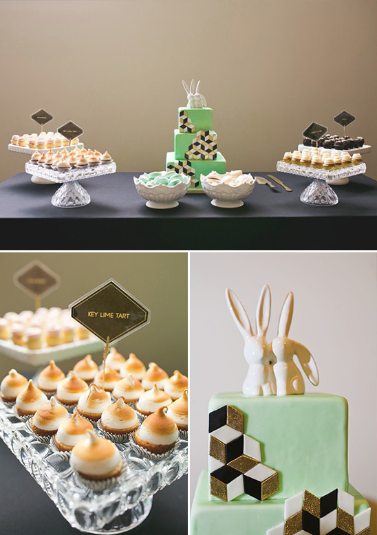 geometic wedding cake with bunny topper and assorted desserts