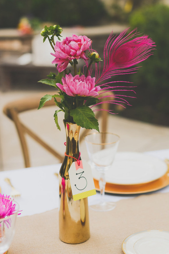 gold and pink floral centerpiece and table number
