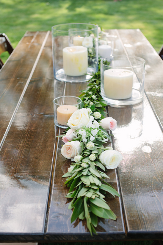 rose garland and hurrican jar candle centerpieces