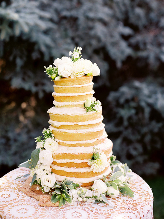 flower topped naked cake by The Patisserie