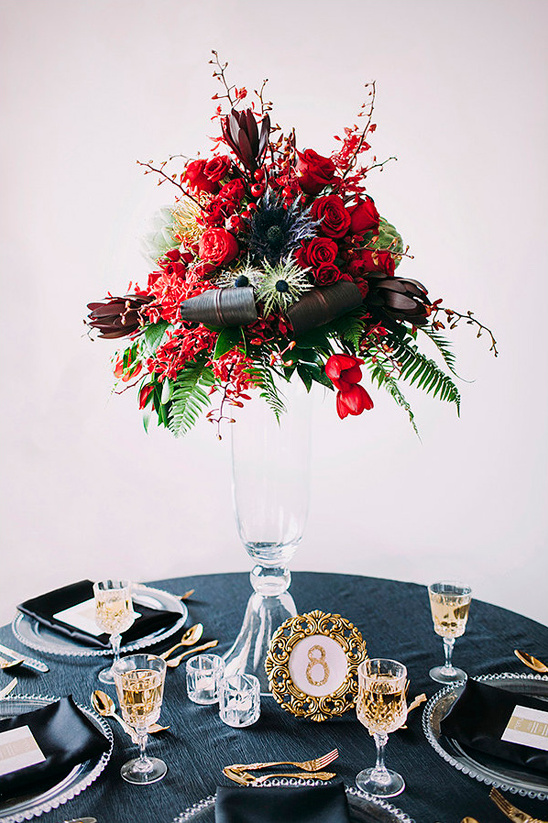 black and gold table decor with red centerpiece