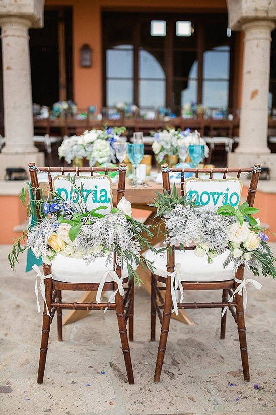 floral accented spanish seat signs