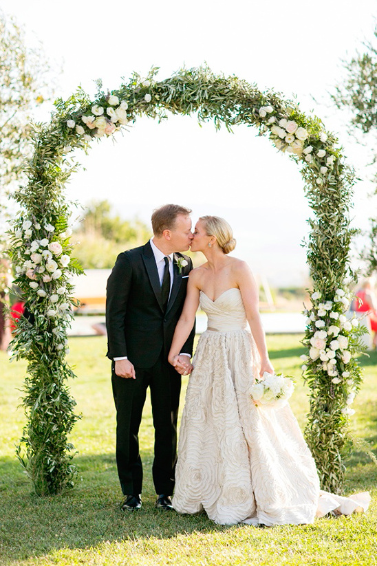 wedding arch and kiss