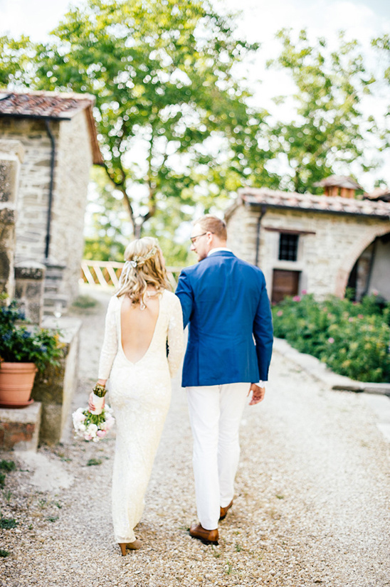 backless dress and deep blue groom look