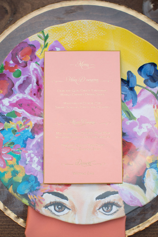 funky patterned plates with peach and gold menu