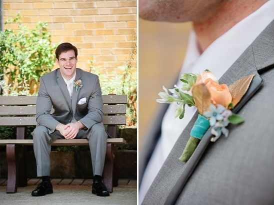 grey suited groom and gold and peach boutonniere