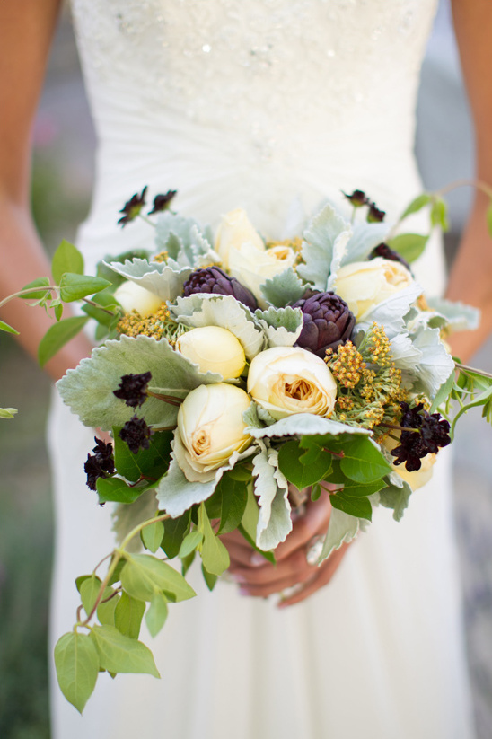 purple artichoke and yellow rose bouquet
