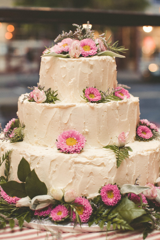 pink flower accented wedding cake from Windfall Market