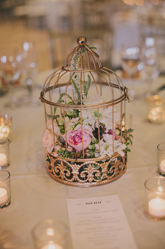 flowers in a gold birdcage