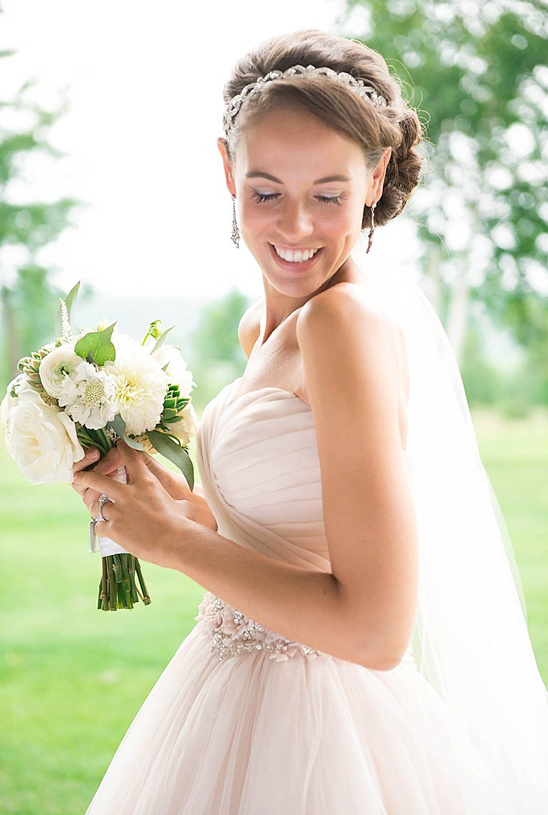 white bouquet and Allure wedding dress