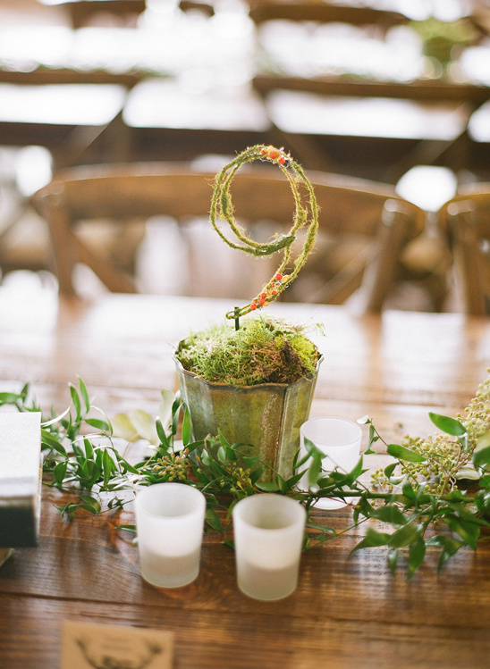 moss covered table numbers photo by Chelsea Mitchell Photography