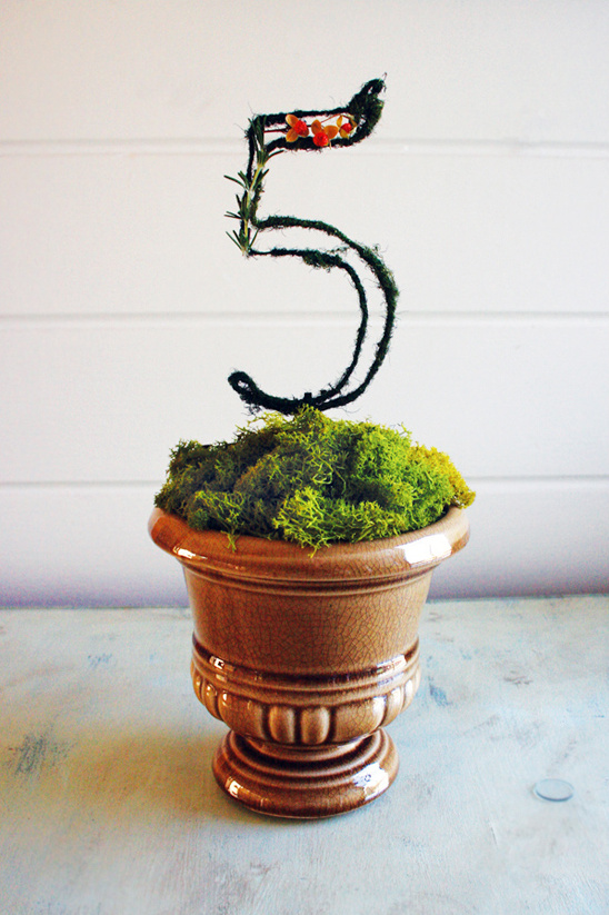 completed moss covered table numbers