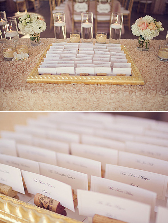 escort card with wine cork stands