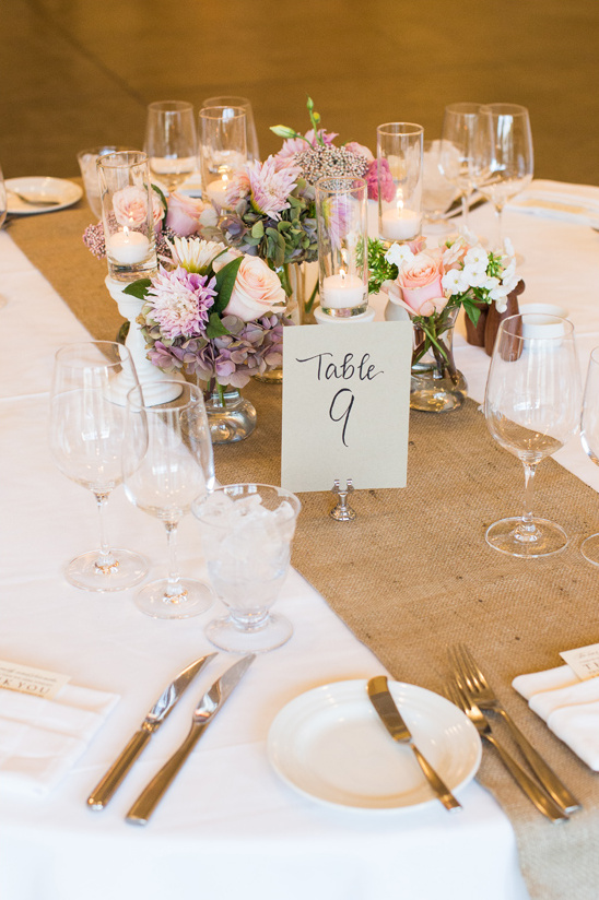 burlap runner and assorted floral centerpieces