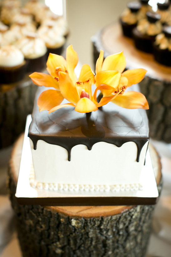 orange orchid topped wedding cake