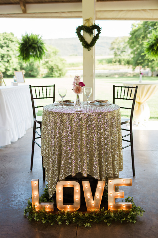 sweetheart table with love marquee sign