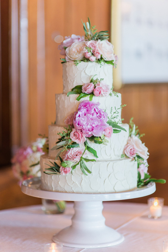 flower topped cake by Branching Out Cakes