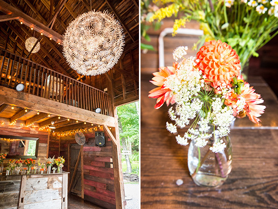 barn reception with daisy chandeliers