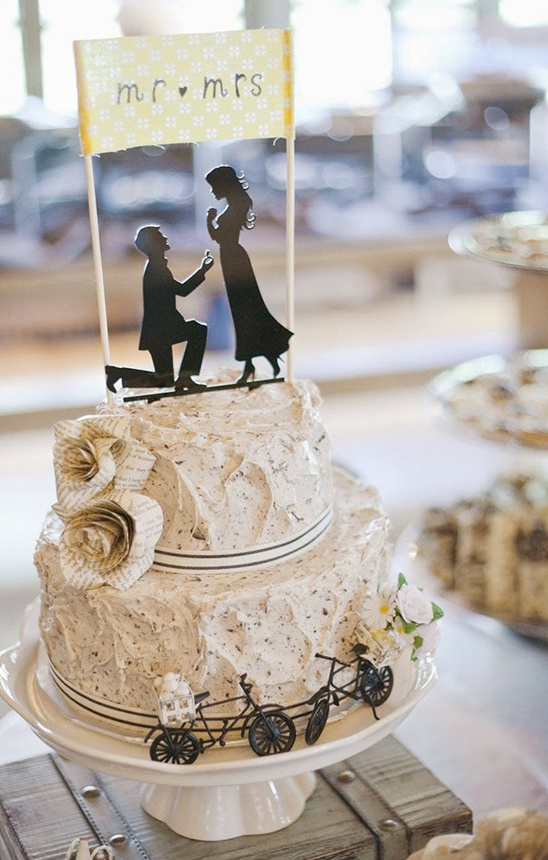 rustic wedding cake with silhouette cake topper