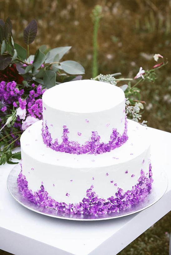 white wedding cake with rock candy