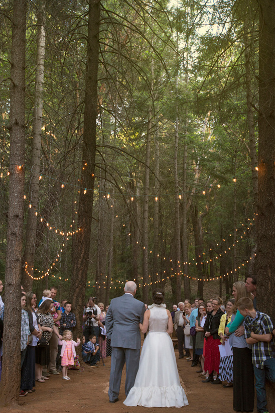 romantic forest ceremony complete with twinkle lights