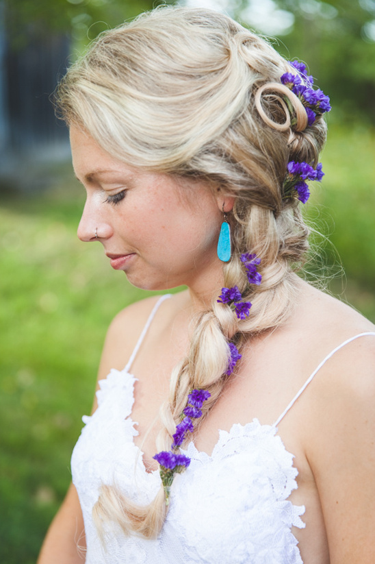 braided wedding hair with purple flowers