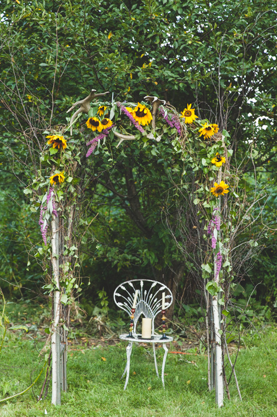 sunflower wild flower and antler wedding arch