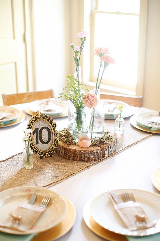 framed table number and rustic centerpiece