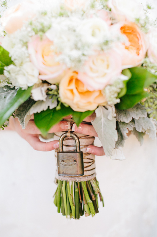 vintage lock on wedding bouquet