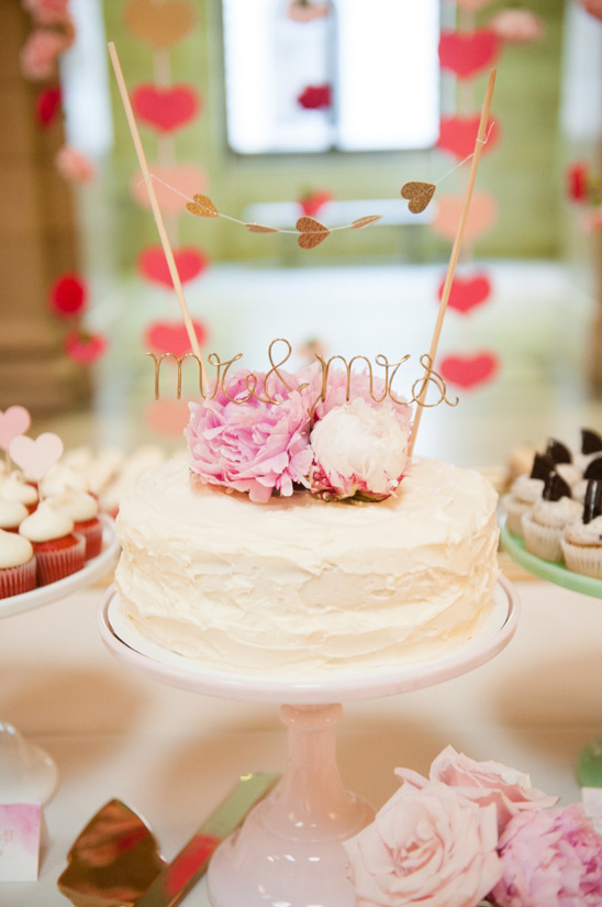 simple wedding cake with heart bunting