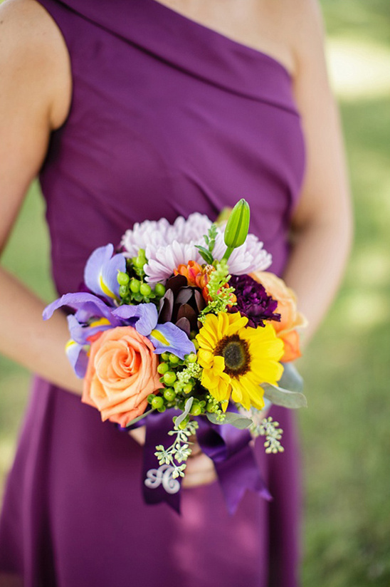 bright bridesmaids bouquet pops against purple dress