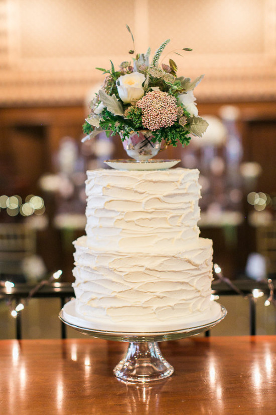 flower filled tea cup topped wedding cake
