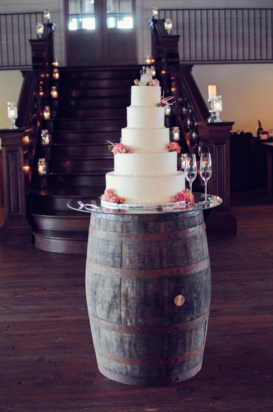 classic wedding cake on a wine barrel cake stand