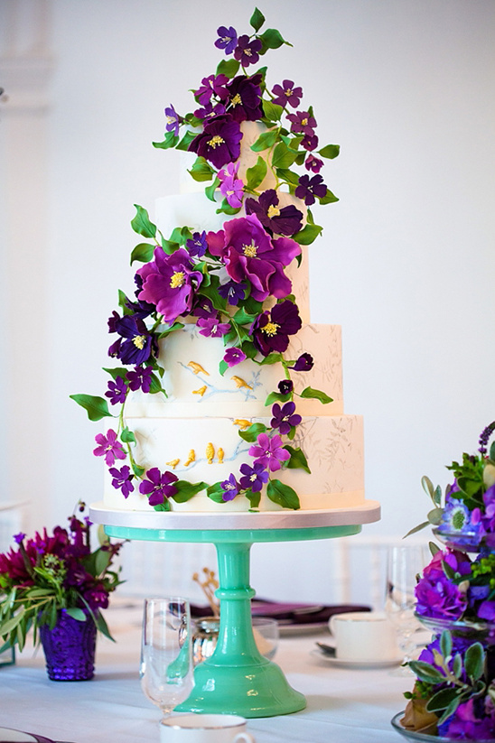 wedding cake with climbing purple flowers