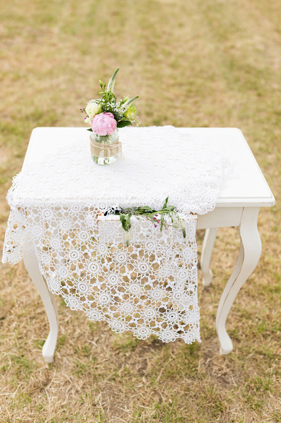 delicate lace covered wedding altar
