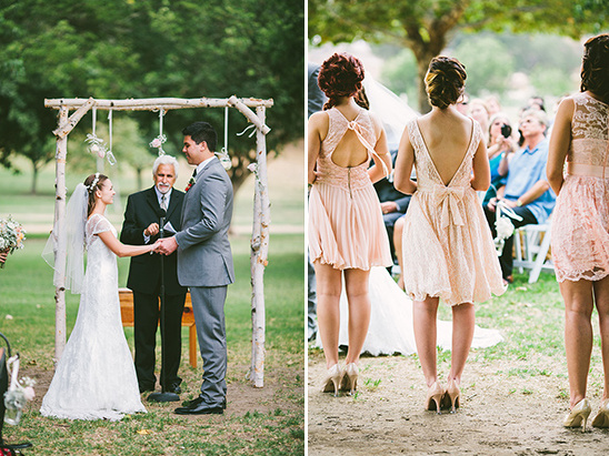 rustic log wedding arch and lacey pink bridesmaid dresses