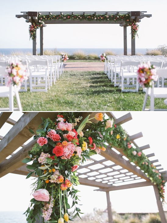 flower garland drapped wedding arbor