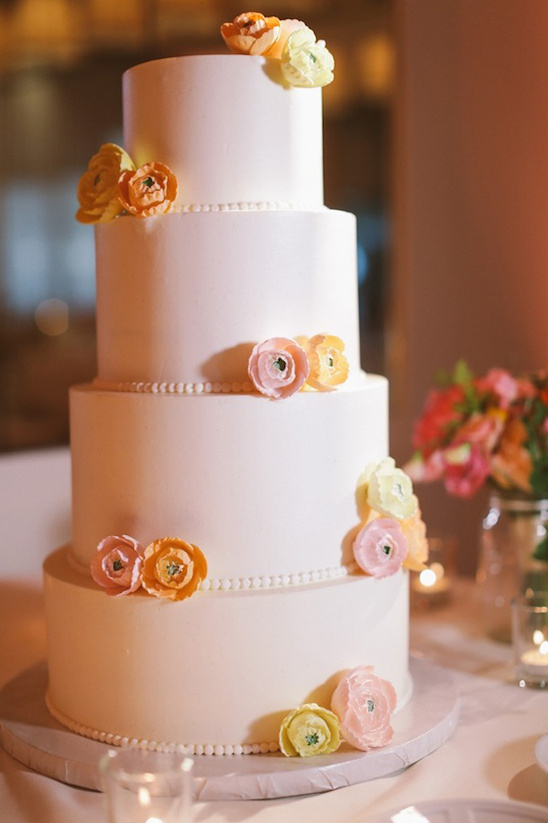 paper flower accented wedding cake