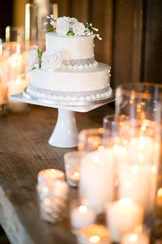 candle lit wedding cake