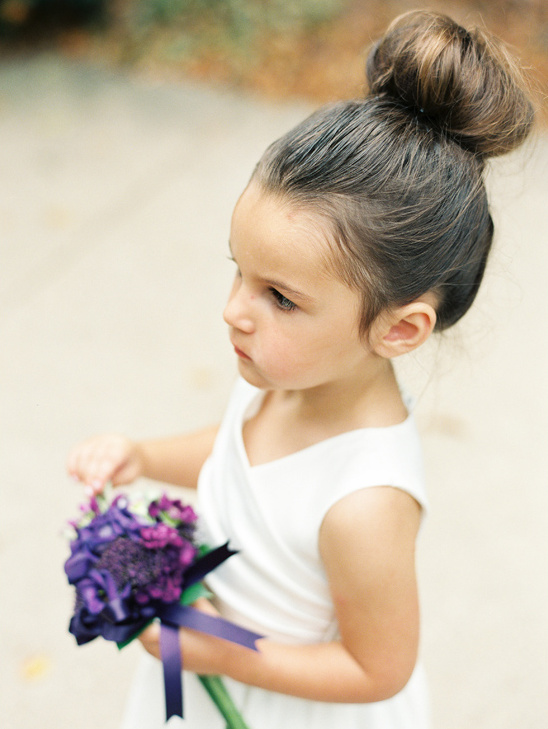 cute flower girl with simple bun hairstyle