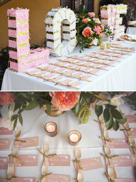 pinata love sign on escort card table