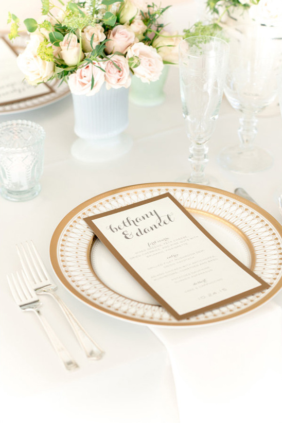classic reception menu and gold rimmed china