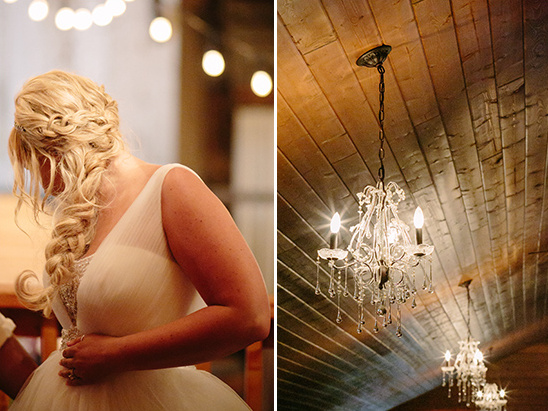braided wedding hair and chandeliere lighting