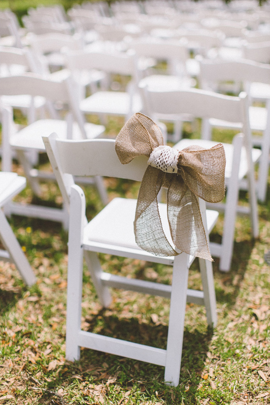 simple burlap bow aisle decor
