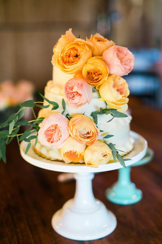 orange garden rose topped cake