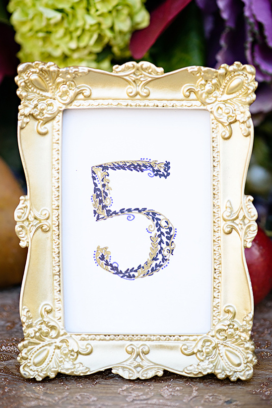gold and purple table numbers