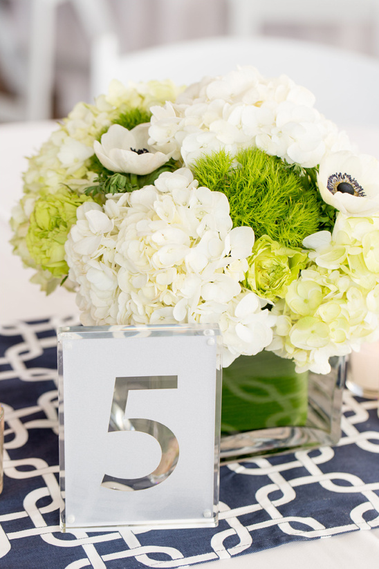 white and green centerpiece clear plexiglass table numbers