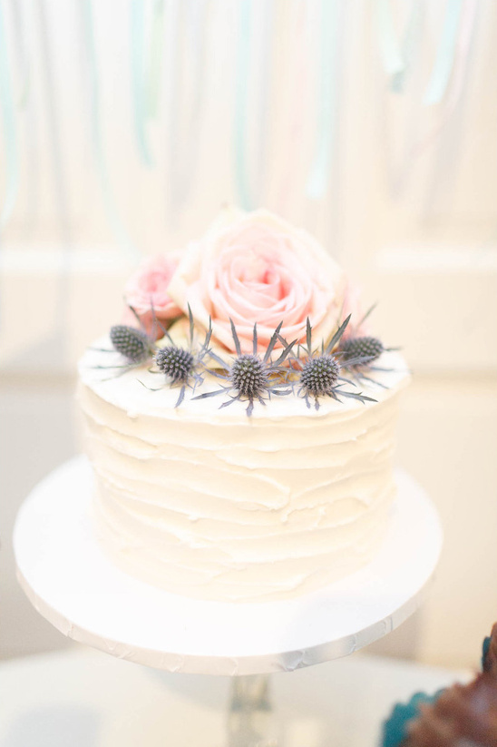 rose and thistle topped wedding cake
